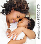 stock-photo-loving-young-african-mother-holding-her-asleep-baby-153205175